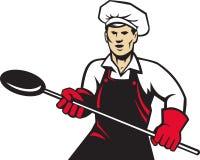 面包师拿着长的平底锅的烘烤把柄 图库摄影
