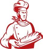 面包师面包运载的主厨大面包 免版税库存图片