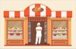 面包店与面包店产品和贝克的工厂建筑物 免版税库存图片