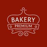 面包店的商标红褐色的背景的 的treadled 免版税库存图片