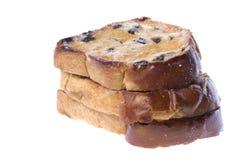 面包敬酒的查出的葡萄干片式 免版税库存图片