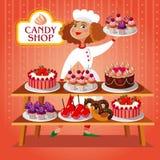 面包点心店的逗人喜爱的糖果商女孩 免版税库存图片