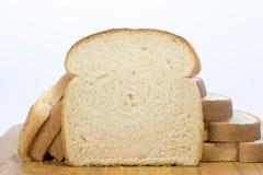 面包片在大面包前的 库存照片