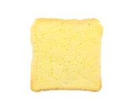 面包片用被隔绝的黄油 免版税库存照片