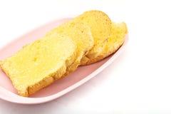 面包被烘烤的黄油和糖 库存照片