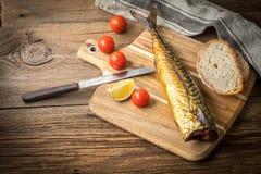 面包鲭鱼抽烟了 库存照片
