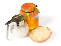 面包黄油蜂蜜牛奶 库存图片