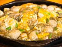 面团鸡蛋油煎的牡蛎 库存照片