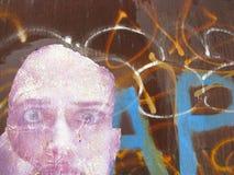 面孔和街道画在棕色背景 库存图片