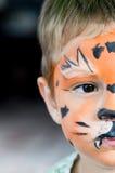 面孔被绘的男孩 库存照片