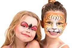 面孔绘画、老虎和瓢虫 免版税库存照片