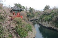 面对河的传统塔在济州,韩国 免版税图库摄影