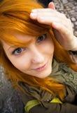 面对青少年愚蠢的做的红头发人 图库摄影