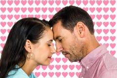 面对面平安的夫妇的综合图象 免版税库存图片