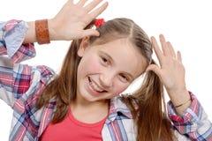 面对滑稽的女孩做的一点 免版税库存照片