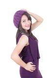 面带帽子微笑的美丽的西班牙女孩 图库摄影