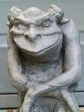 面貌古怪的人雕象 免版税库存图片