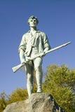 从革命战争的民兵战士招呼访客到历史列克星敦,马萨诸塞,新英格兰 免版税库存照片