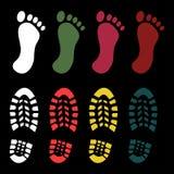 鞋子和赤脚印刷品 库存图片