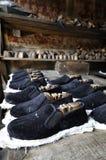 鞋子的古老生产 库存图片