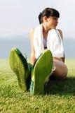鞋子绿色脚底 库存照片