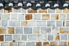 韩国传统灰色砖墙 免版税图库摄影