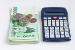 韩国赢取了货币按10 000被赢取的价值,保存金钱概念 免版税库存图片
