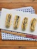 韩国食物黑色芝麻powderedÂ大豆糯米糕 图库摄影