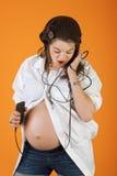 音乐孕妇 库存图片