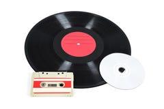 音乐存贮设备-唱片、模式卡式磁带和CD 免版税库存照片