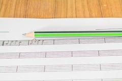 音乐笔记和铅笔 免版税库存图片