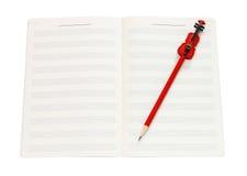 音乐笔记本和红色小提琴书写与裁减路线 免版税库存图片