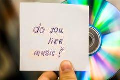 音频CD 题字`做您喜欢音乐?` 免版税库存照片