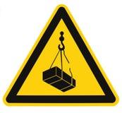 顶上的危险,起重机装载落的危险风险标志,货物象标志,隔绝了在黄色,大宏观特写镜头的黑三角 免版税库存照片