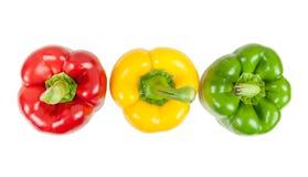 顶视图三上色了在白色的胡椒 免版税库存照片