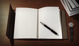 顶视图与笔记薄、笔、书和手表的办公桌大模型 免版税库存照片