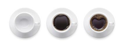 顶视图-心脏形状或爱标志在咖啡杯,空的coffe 免版税库存图片