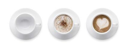 顶视图-心脏形状或爱标志在咖啡杯,空的coffe 图库摄影