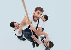 顶视图 绳索的建筑登山人 免版税图库摄影