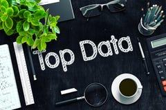 顶面数据-在黑黑板的文本 3d翻译 图库摄影