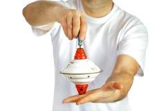 顶面玩具在手上 免版税图库摄影