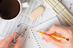 项目编制,写新的数据给笔记本 免版税库存照片