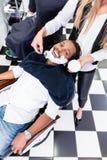 顾客在与剃须膏的理发店 免版税库存图片