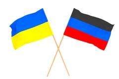 顿涅茨克人民共和国的乌克兰的旗子和旗子 库存照片