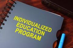 预定与标题被赋予个性的教育计划& x28; IEP& x29; 免版税图库摄影