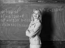 预期老师必须考虑的工作条件 老师的工作条件 她喜欢她的工作 ?? 库存图片