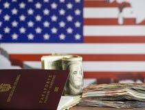 预算的概念,财务和民族主义-在背景中美国国旗和获利美元和哥伦比亚的钞票 免版税库存图片