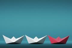 领导纸小船概念 库存图片