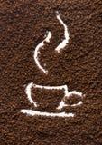 颗粒状咖啡和杯子 库存图片