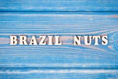 题字在老委员会的巴西坚果 图库摄影